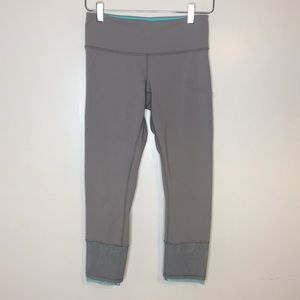 Lululemon gray with Teal leggings. Size 6